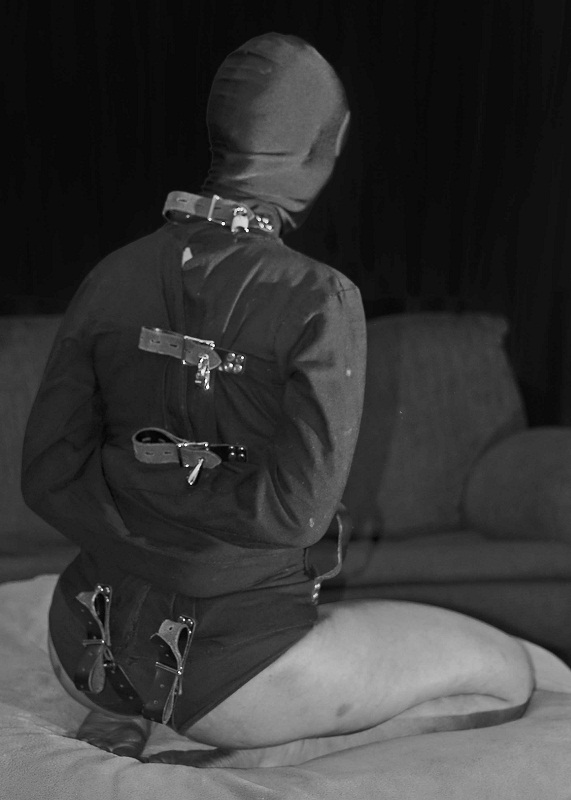 Kneeling in straitjacket from the back